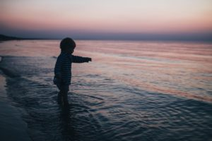 Kid In Ocean